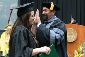 President Tony Frank congratulates his daughter Megan at the College of Health and Human Sciences Spring 2016 Commencement Ceremony in Moby Arena.
