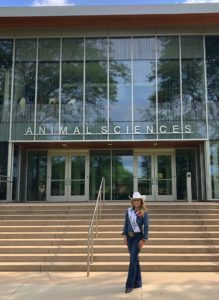 Hailey Fredricksen poses in front of CSU's Animal Sciences building