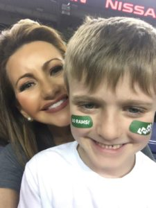 Kathleen Reid Pitre with her son at the Rocky Mountain Showdown