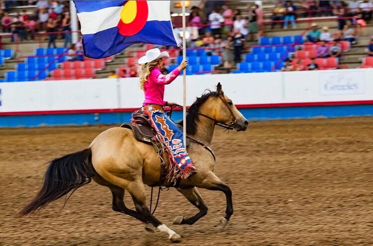 Miss Rodeo Colorado Hailey Frederiksen riding a horse at the Greeley Stampede
