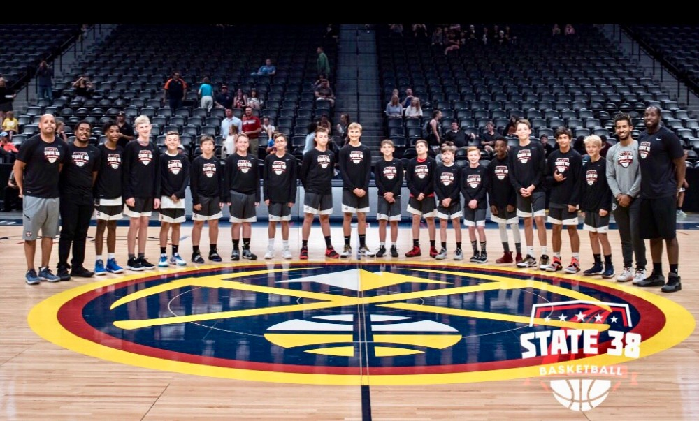 Will Bell, right, with State 38 players at the Pepsi Center for a tournament.