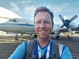 Tim Lang with airplane in background