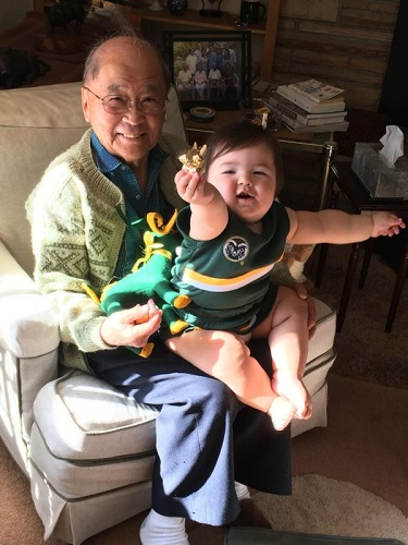 Dr. John Matsushima and granddaughter