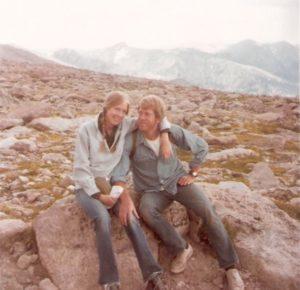 couple posing on mountain trail