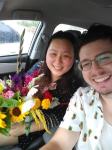 Jared and his wife, with flowers