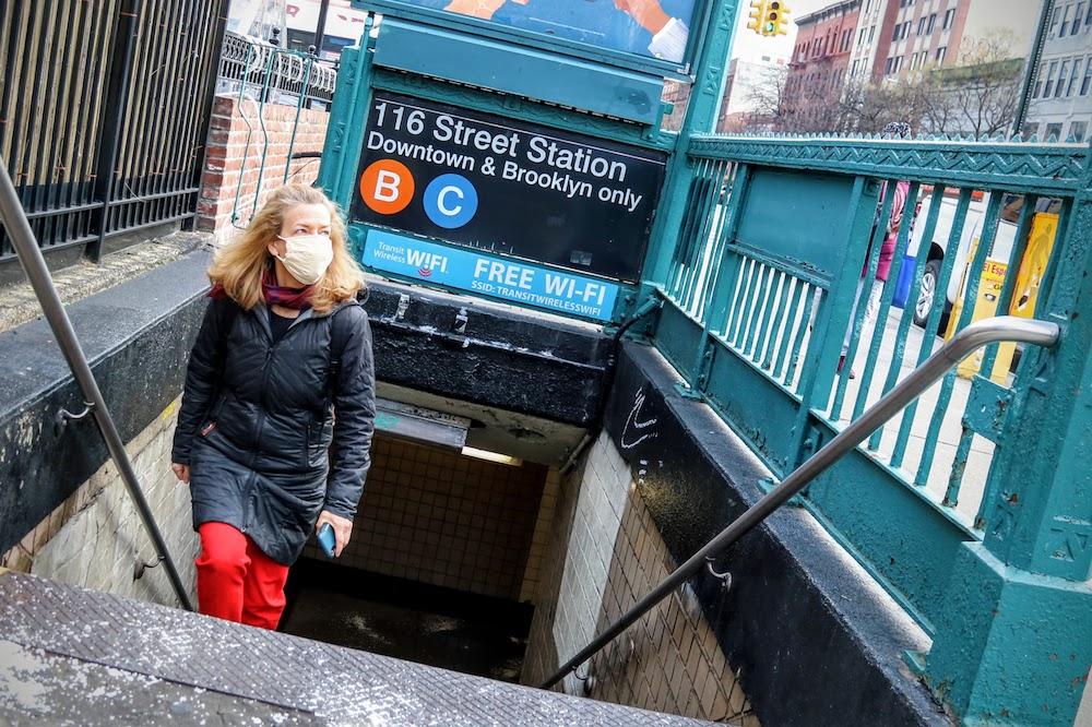 Woman emerging from NY subway entrance