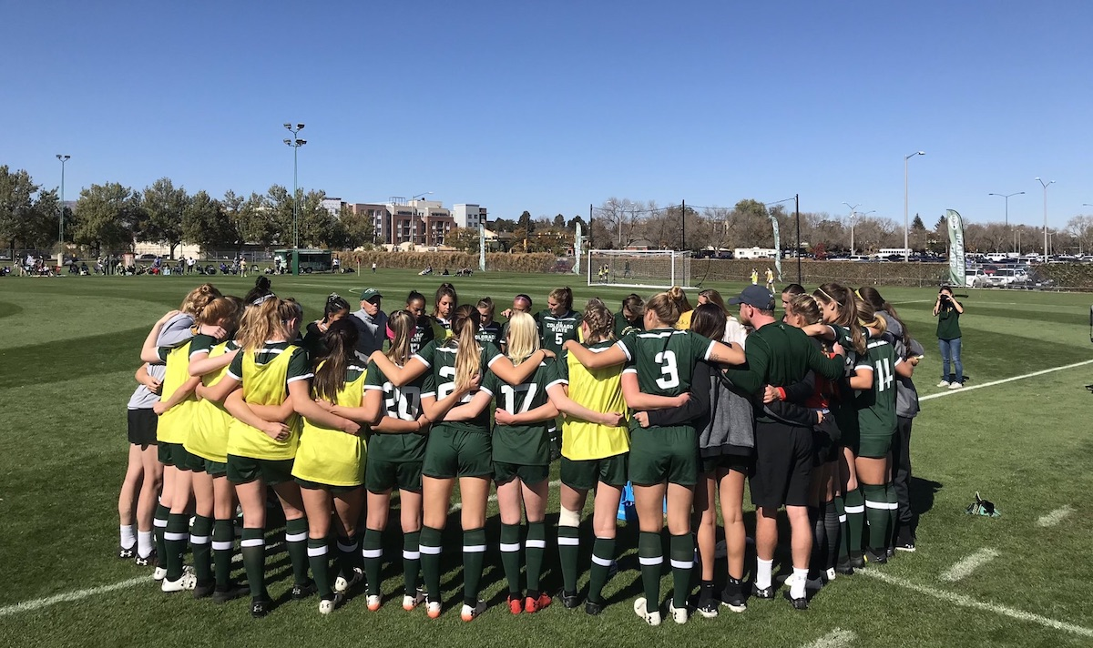 CSU soccer team huddle. Ally is pictured in the center wearing number 17.