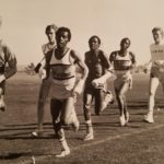 sepia toned image of cross country runners at a meet